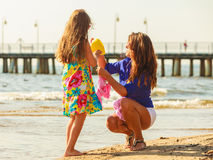 Mother and daughter playing on beach. Royalty Free Stock Photo
