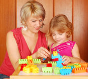 Mother and daughter playing with blocks. Mother and daughter playing with toy blocks Royalty Free Stock Image
