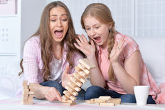 Mother and daughter   playing board game Stock Images