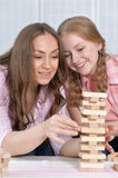 Mother and daughter   playing board game Royalty Free Stock Photography