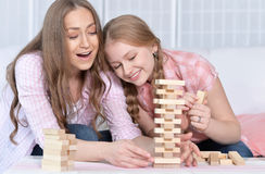 Mother and daughter   playing board game Stock Photos