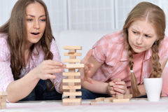 Mother and daughter   playing board game Stock Photo