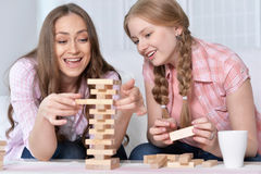 Mother and daughter   playing board game Royalty Free Stock Photos
