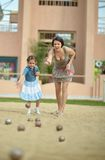Mother and daughter playing Boules game Royalty Free Stock Photo