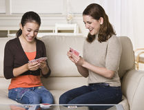 Mother and Daughter Playing Cards Stock Photos