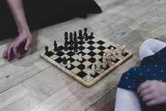 Playing chess on wooden floor royalty free stock photography