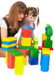Mother and daughter playing with color toys Stock Photo