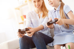 Mother and daughter playing on console Stock Image