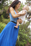 Mother And Daughter Playing In CountrysideTogether Stock Photography