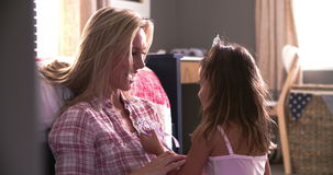 Mother And Daughter Playing Dressing Up Game In Bedroom stock video