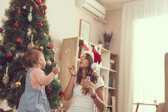Mother and daughter making soap bubbles Royalty Free Stock Image