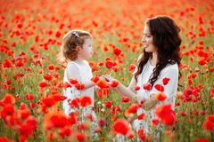 Mother and daughter playing in flower field Royalty Free Stock Photo