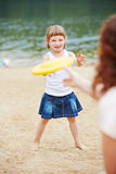 Mother and daughter playing frisbee Stock Image