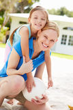 Mother And Daughter Playing Game Of Volleyball In Garden Stock Photography