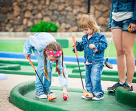 Mother and daughter playing golf on a golf course Royalty Free Stock Photography