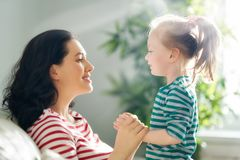 Mother and daughter playing royalty free stock photo