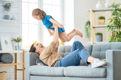 Mother and daughter playing. Happy mother`s day! Mom and her daughter child girl are playing, smiling and hugging. Family holiday and togetherness royalty free stock image