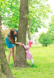 Mother and daughter playing hide and seek Stock Image