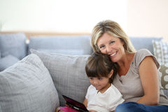 Mother and daughter playing at home Royalty Free Stock Photos