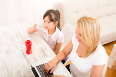 Mother and daughter playing at home Stock Photography