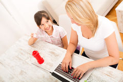 Mother and daughter playing at home Royalty Free Stock Images