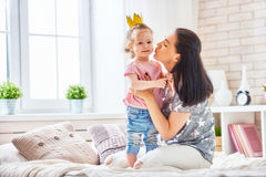 Mother and daughter playing and hugging Royalty Free Stock Photo