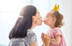 Mother and daughter playing and hugging Royalty Free Stock Photography