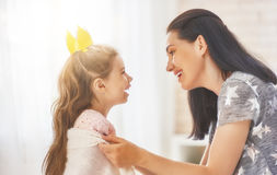 Mother and daughter playing and hugging Royalty Free Stock Image