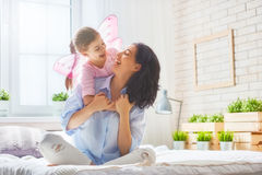 Mother and daughter playing and hugging Royalty Free Stock Photos
