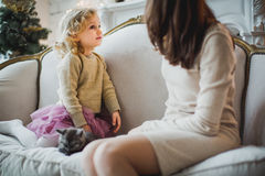 Mother and daughter are playing with kitten Royalty Free Stock Photography