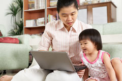 Mother and daughter playing laptop together Royalty Free Stock Photo