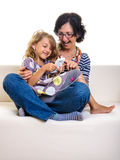 Mother and daughter playing with mobile phone Royalty Free Stock Photos
