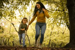 Mother and daughter playing in nature. Royalty Free Stock Photo