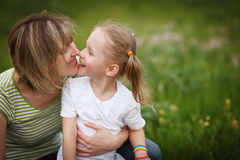 Mother and daughter playing outdoors Stock Images