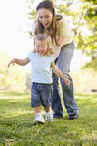 Mother and daughter playing outdoors Royalty Free Stock Images
