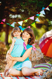 Mother and daughter playing outdoors in summer Royalty Free Stock Images