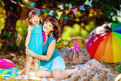 Mother and daughter playing outdoors in summer Stock Photography