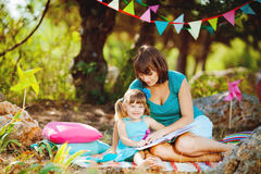 Mother and daughter playing outdoors in summer Stock Image