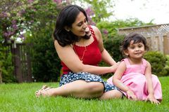 Mother and daughter playing outside stock photo