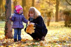 Mother and daughter playing in the park Stock Photography