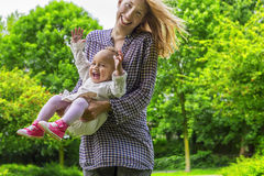 Mother and daughter playing in the park royalty free stock image