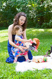 Mother and daughter playing in park Royalty Free Stock Photo