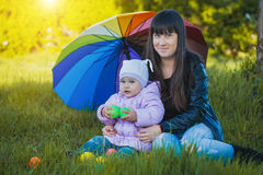 Mother and daughter are playing in the park Stock Images