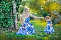 Mother and daughter playing in the park together happy woman freedom power feelings royalty free stock image