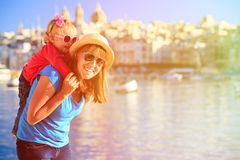 Mother and daughter playing on the quay of Malta Stock Photography