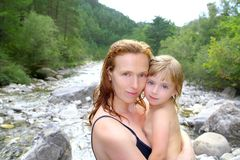 Mother daughter playing in river after swimming Royalty Free Stock Photo