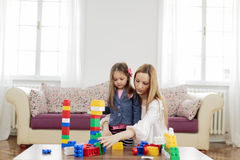 Mother and daughter playing in room. Mother and daughter playing in the room Royalty Free Stock Images