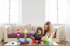 Mother and daughter playing in the room Royalty Free Stock Photos