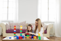 Mother and daughter playing in the room Royalty Free Stock Images