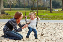 Mother and daughter playing with sand in park Stock Photography